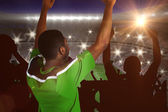 Cheering football fan in green jersey — Stock Photo
