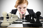 Focused businesswoman with chessboard — Stock Photo