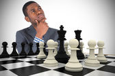 Businessman thinking with chessboard — Stock Photo