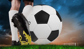 Football boot kicking huge ball — Stock Photo