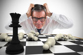 Businessman touching his head with chessboard — Stock Photo