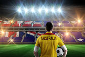 Australia football player holding ball — Stock Photo