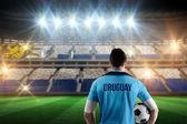 Composite image of uruguay football player holding ball — Stock Photo