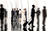Business colleagues looking against large window — Stock Photo