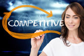 Businesswoman writing word competitive — Stock Photo