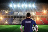 France football player holding ball — Stock Photo