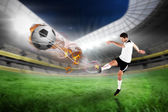 Football player in white kicking — Stock Photo