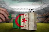 рука, строительство стены флаг алжира — Стоковое фото