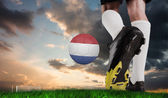 Football boot kicking dutch ball — Stock Photo
