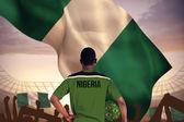 Nigeria football player holding ball — Stock Photo