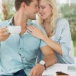 Hip couple enjoying coffee — Stock Photo