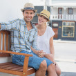 Couple sitting on bench smiling — Stock Photo #48324593