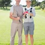 Golfing couple holding clubs — Stock Photo #48324733