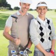 Golfing couple on the putting green — Stock Photo #48325035