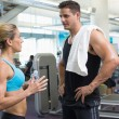 Bodybuilding man and woman talking together — Stock Photo #48325139