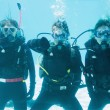Friends on scuba training submerged in pool — Stock Photo #48325235