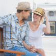 Couple sitting on bench — Stock Photo #48325503