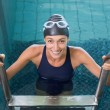 Swimmer getting out of the swimming pool — Stock Photo #48325515