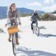 Couple going on a bike ride on the beach — Stock Photo #48325725