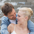 Couple sitting on steps showing affection — Stock Photo #48326147