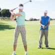 Golfing couple teeing off for the day — Stock Photo #48326481
