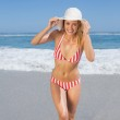 Woman in bikini and sunhat at beach — Stock Photo #48326711
