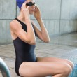 Swimmer sitting at the edge of the swimming pool — Stock Photo #48327127
