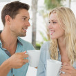 Hip couple having coffee together — Stock Photo