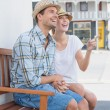 Hip couple sitting on bench — Stock Photo #48328009