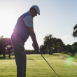 Golfer teeing off for the day — Stock Photo #48328255
