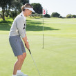 Lady golfer on the putting green — Stockfoto #48328437