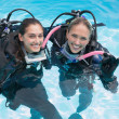Friends on scuba training in swimming pool — Stock Photo #48328997