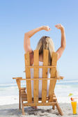 Blonde in deck chair with cocktail — Stock Photo
