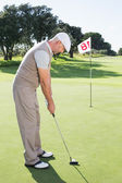 Golfer on the putting green — Stock fotografie