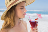 Blonde sipping cocktail — Stock Photo