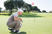 Golfista sul putting green — Foto Stock