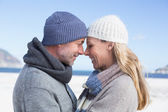 Couple on the beach in warm — Stock Photo