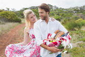 Couple going for a picnic smiling at each other — Stock Photo