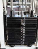 Heavy weights on the weight machine — Stock Photo