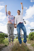 Couple leaping in their garden — Stock Photo