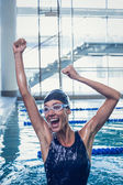 Swimmer jumping up swimming pool — Stock Photo
