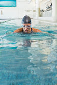Swimmer coming up for air — Stock Photo