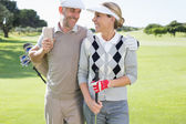 Golfing couple on the putting green — Stok fotoğraf