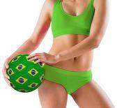 Girl holding brazil ball — Stockfoto
