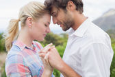 Couple standing outside holding hands — Stock Photo