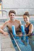 Man and woman with rollers in the pool — Foto Stock