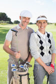 Golfing couple on the putting green — Stock fotografie