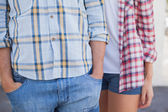 Couple wearing check shirts and denim — Stock Photo