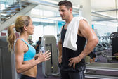 Bodybuilding man and woman talking together — Stock Photo