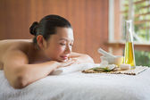 Brunette lying on massage table — Stock Photo
